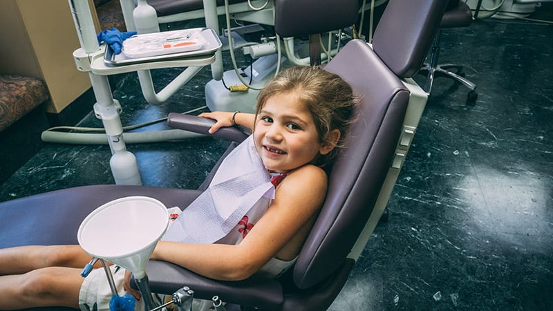 Child sittin on a dental chair - My Kids Hometown Dentist